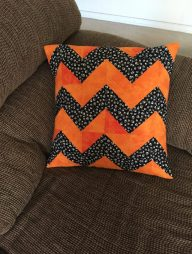 orange black chevron pillow