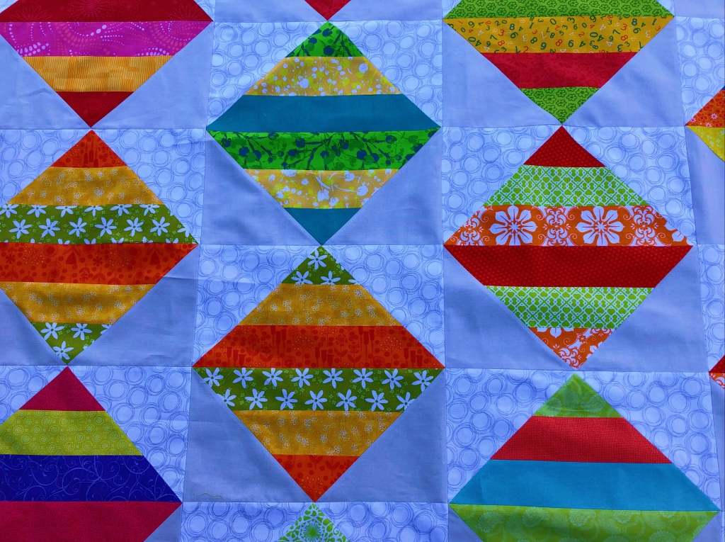 pieced flying geese quilt