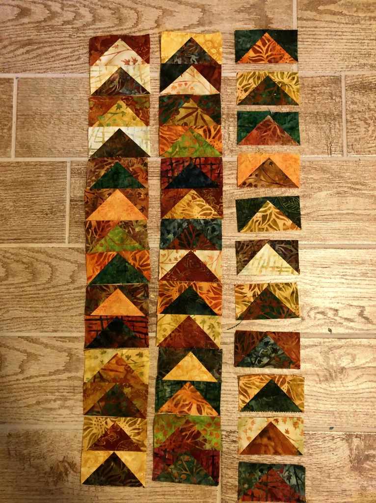 charm pack flying geese quilt wip