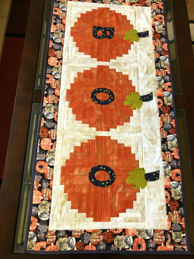 Curvy log cabin table runner Halloween