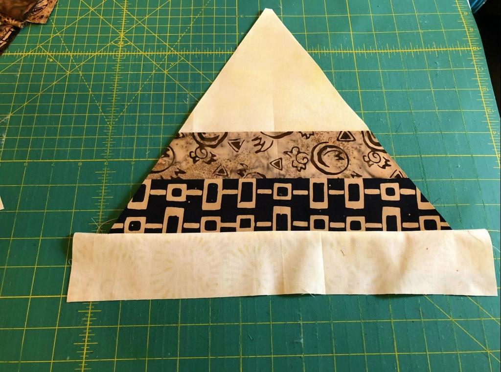 strip pieced hexagon triangle