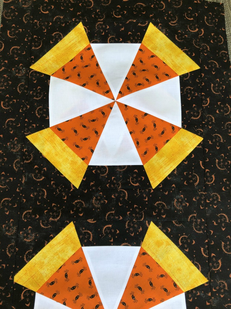 candy corn kaleidoscope quilted table runner